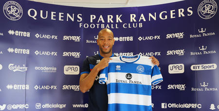 Defender Alex Baptiste holds the QPR shirt up