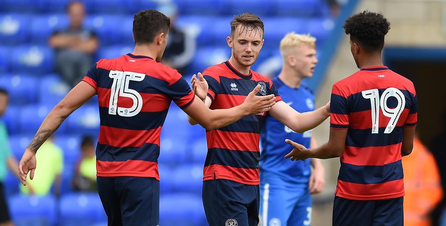 Charlie Owens (centre) celebrates his goal