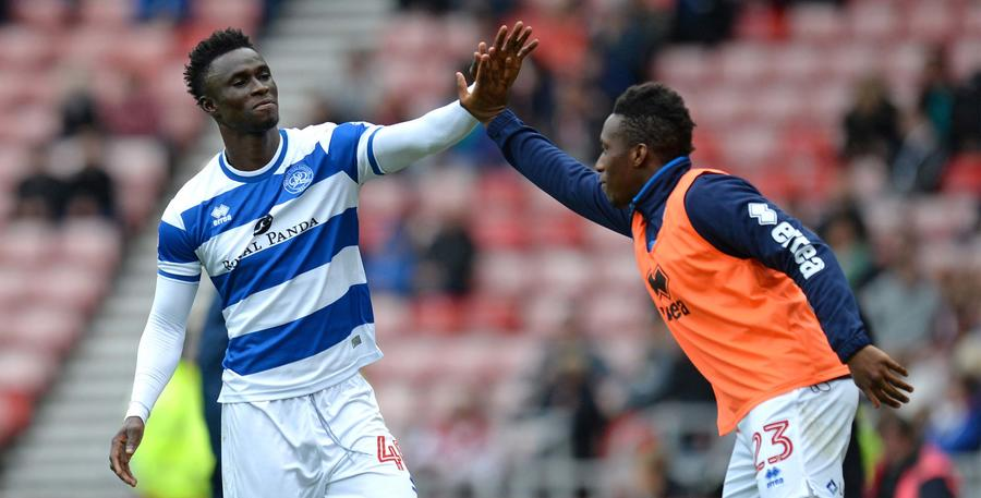 High five from teammate Yeni Ngbakoto on the QPR bench