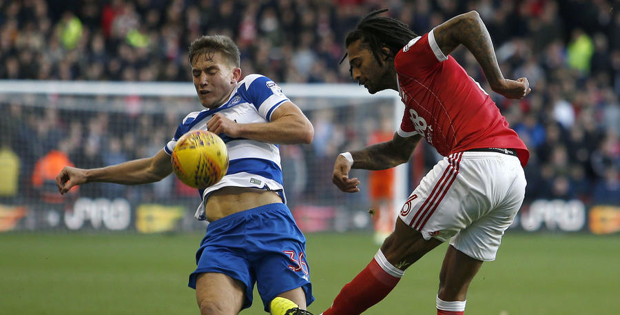 David Wheeler tries to block a clearance from Armand Traore