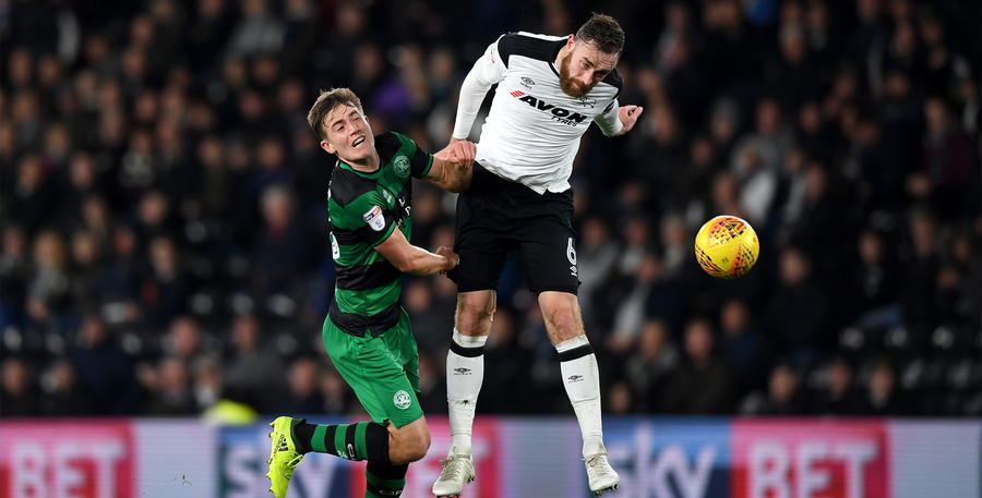 Richard Keogh beats David Wheeler to the ball
