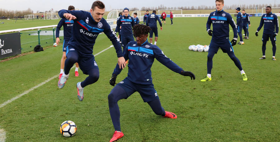 Josh Scowen avoids the returning Eberechi Eze in training