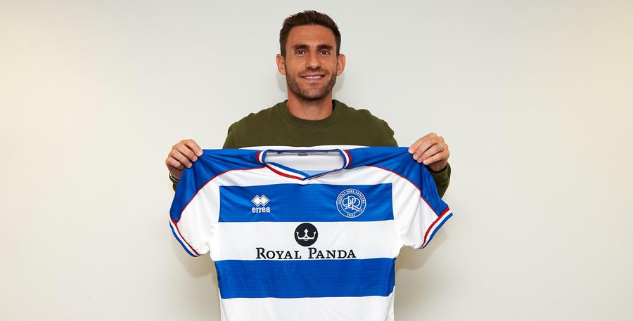 Right-back Rangel holds the QPR shirt aloft