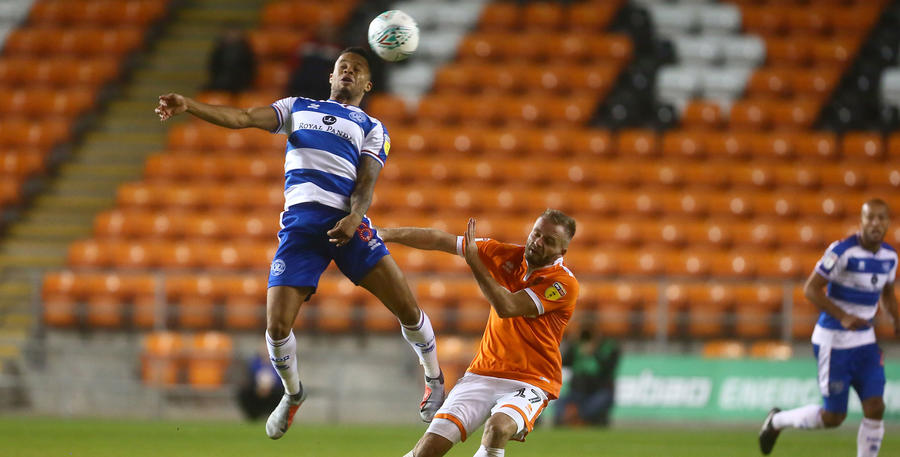 Jordan Cousins out leaps Ryan McLaughlin of Blackpool