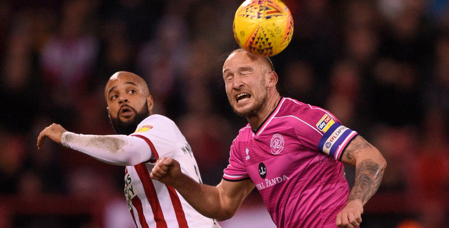 Toni Leistner gets his head to the ball ahead of McGoldrick