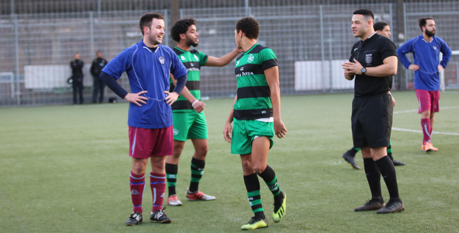 A friendly disagreement between both sides and the ref