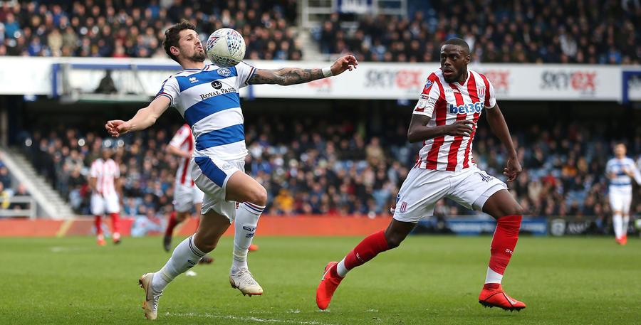 Pawel Wszolek brings the ball down under pressure from Bruno Martins