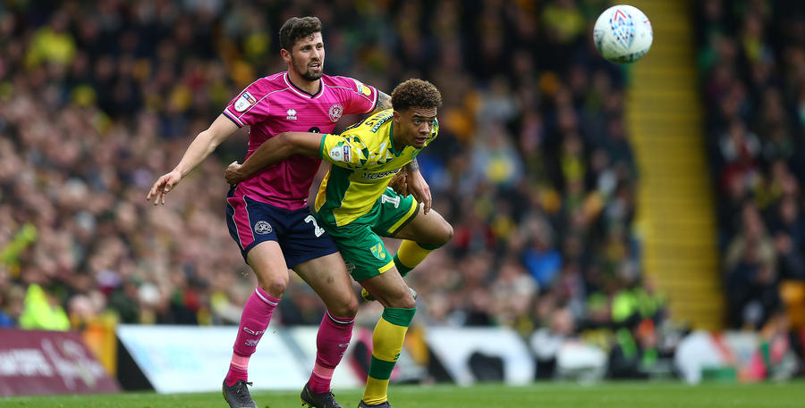 Pawel Wszolek tussles for possession at Carrow Road.