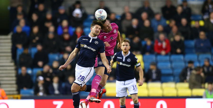 Matt Smith gets in on the aerial tussle at The Den.