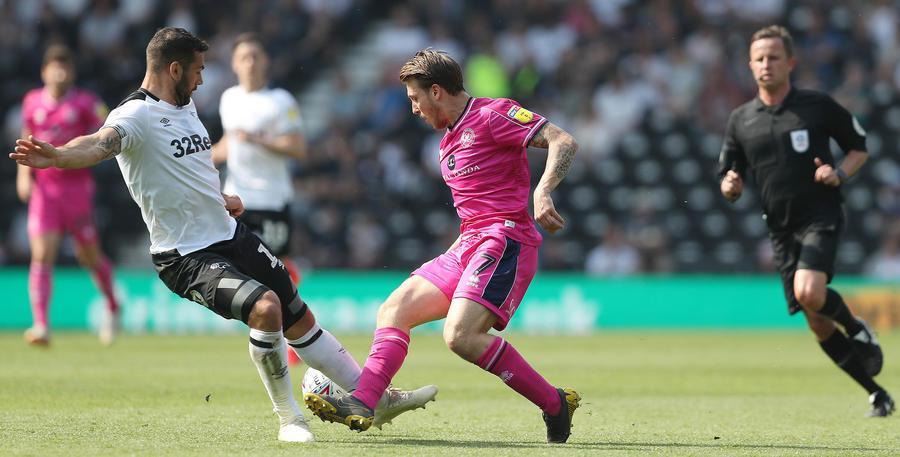 Luke Freeman skips away from Bradley Johnson in midfield
